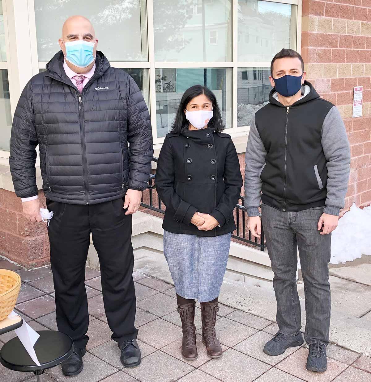 Three people standing, posed photo