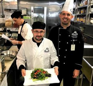 Student Joel Diaz (left) and BPACE's Chef Brandon Palmer (right) create expertly designed and healthy dishes as part of Baldwin Park's Adult and Community Education's culinary arts academy.