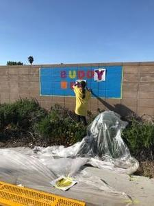 buddy bench being painted at ramblewood elementary