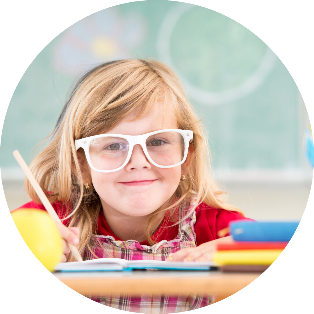 young girl wearing glasses holding a pencil