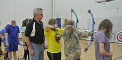 Russ Warner teaching archery to the PE classes at BUHS