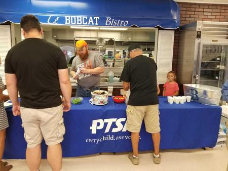 PTSA serving parents at the Baked Potato Bar
