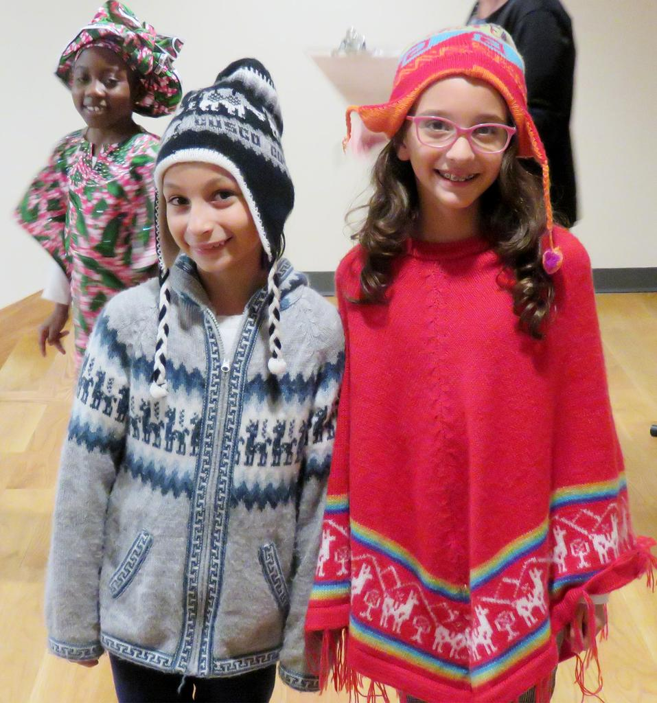 Two students wearing clothes that represent their heritage