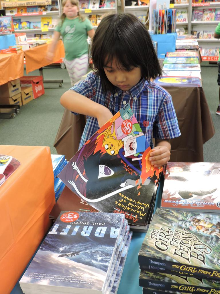 Student browsing at book fair