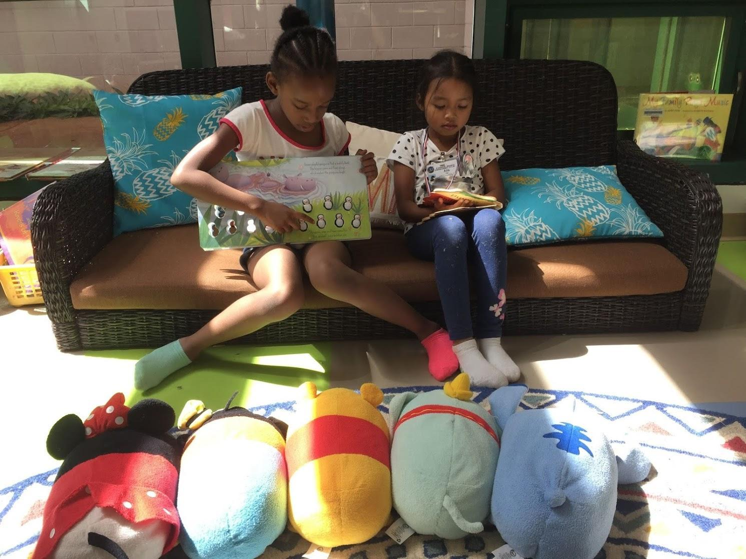 Students reading to stuffed animals