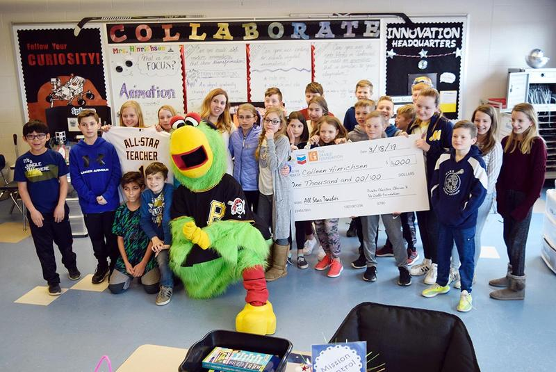 "In addition to being named an ""All-Star Teacher,"" Mars Area teacher Colleen Hirichsen (pictured with the Pirate Parrot and students in her Mars Area Centennial School STEAM class) was presented with a $1,000 grant from Pirates Charities, Chevron and The Grable Foundation."
