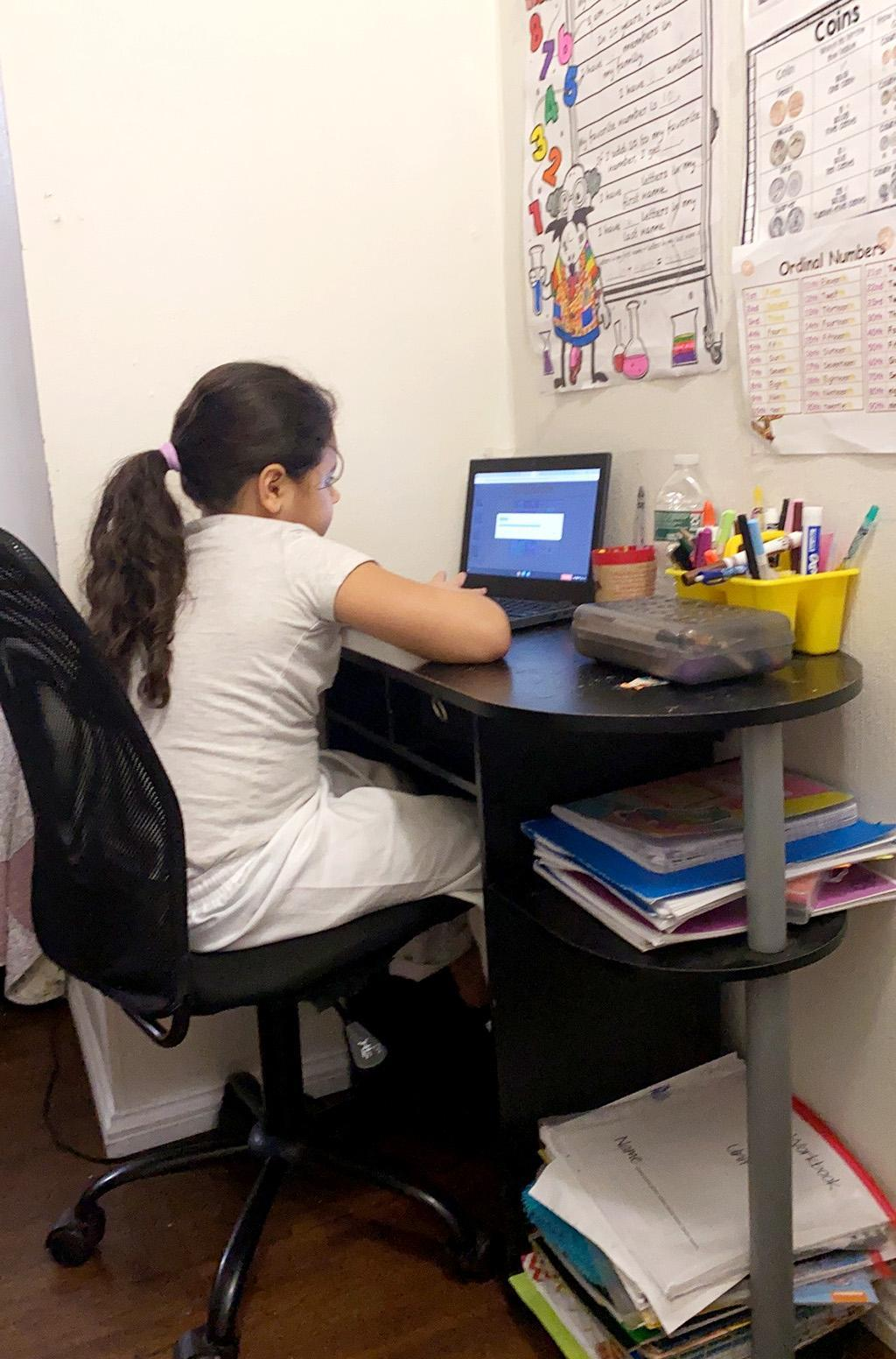 A student sitting a new desk