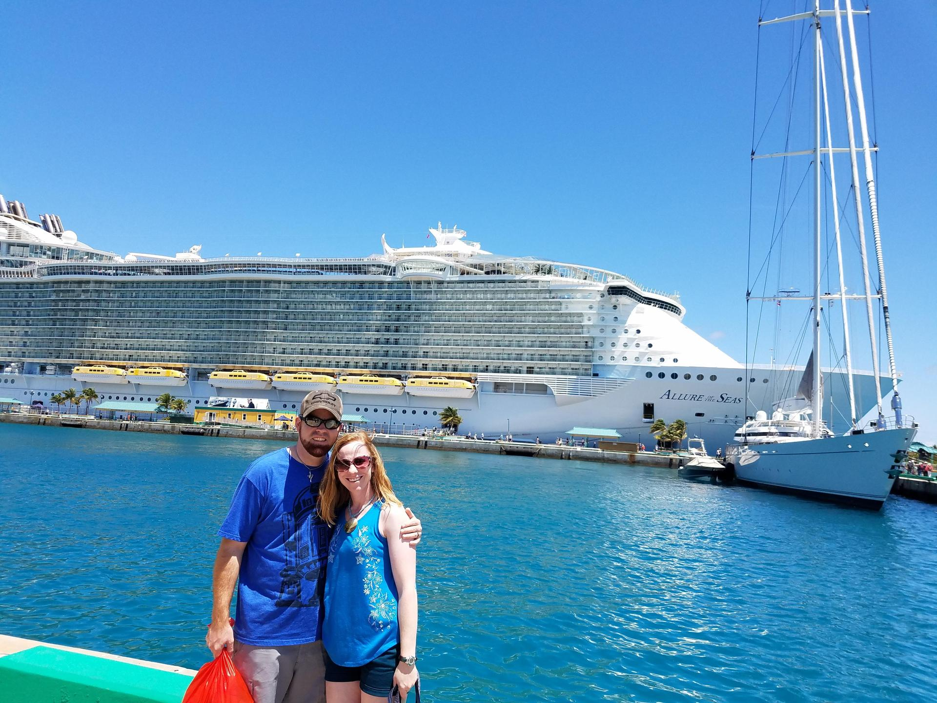 My husband and I standing in front of our cruise ship.