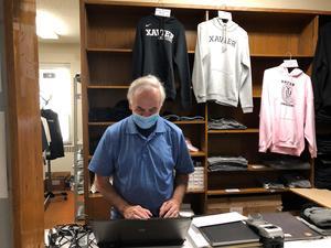 Bro. John in school store at Xavier