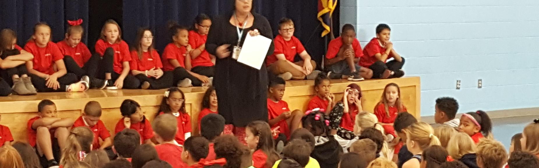 speaking at Red Ribbon student Assembly