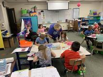 Students work with Mrs. Johnson