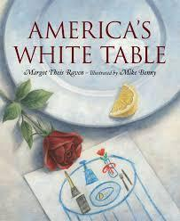 table with a white cloth on top