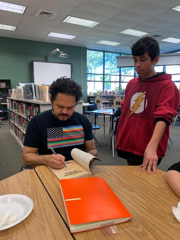 Author Raul the Third signs books for student