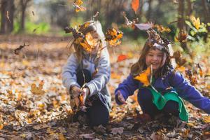 Kids throwing fall leaves
