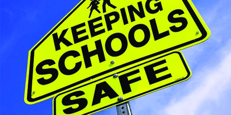 Picture that says Keeping Schools Safe