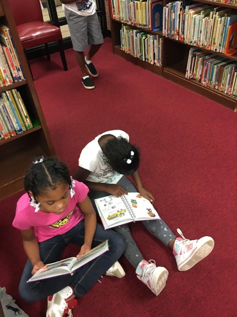 Students enjoying their new book.
