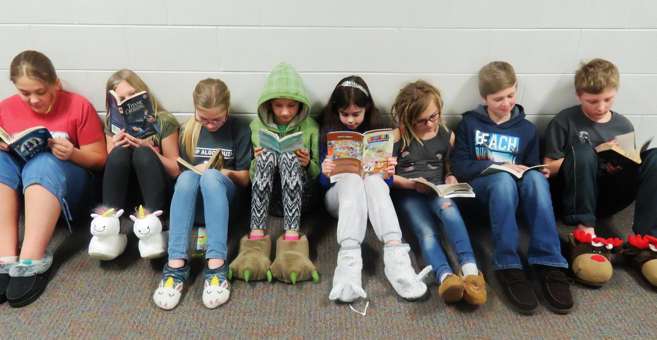 Page students enjoy hallway reading during reading month.