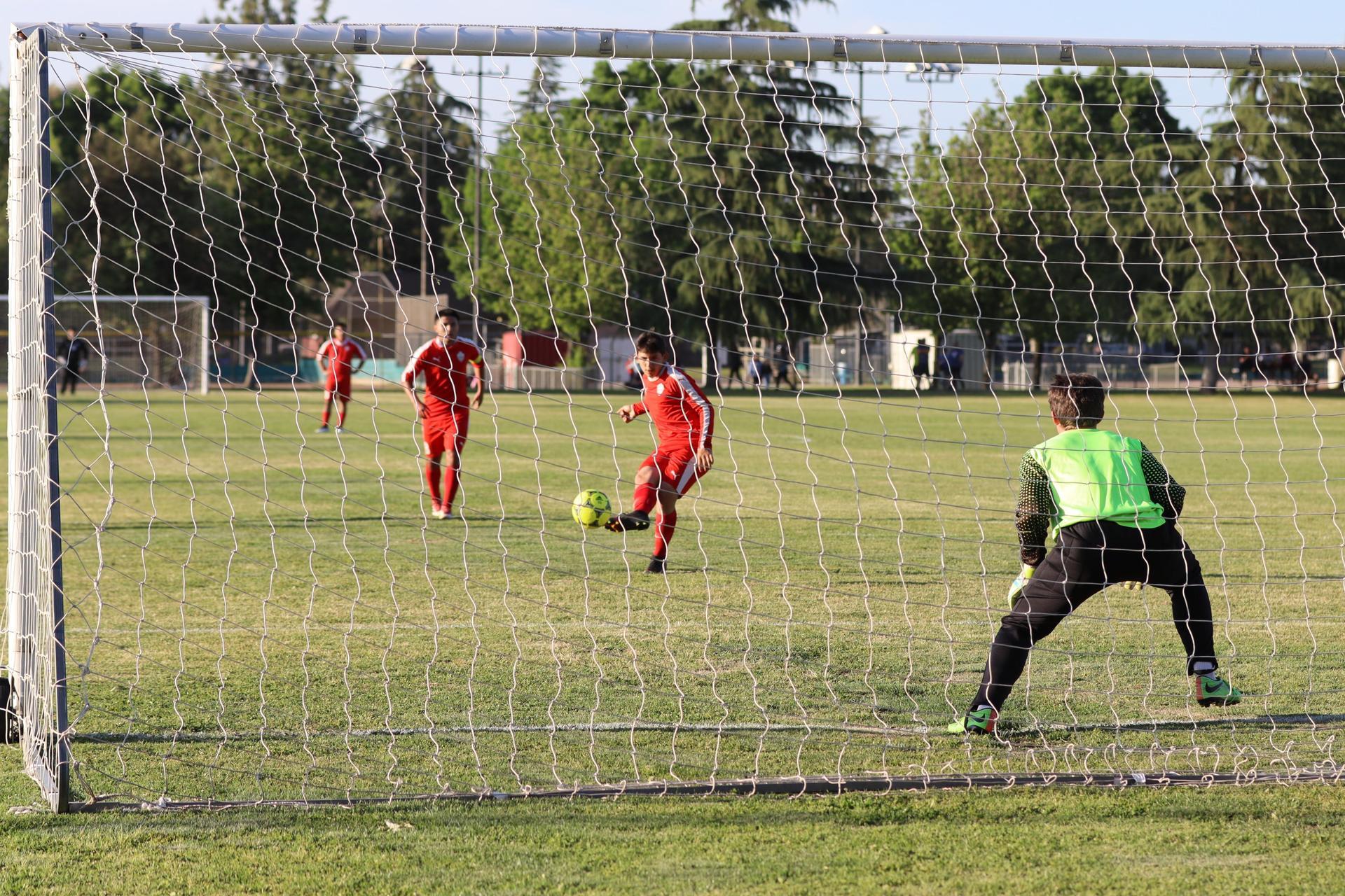 boys playing soccer against Yosemite