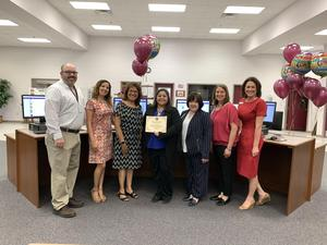 Teacher being awarded Future Ready Teacher Grant by Administrators