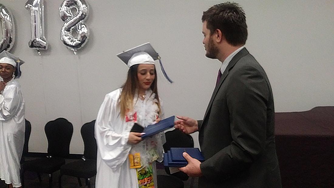 Adam Jones congratulates a graduate