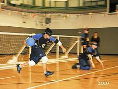 2010 photo of two NYI students playing goalball