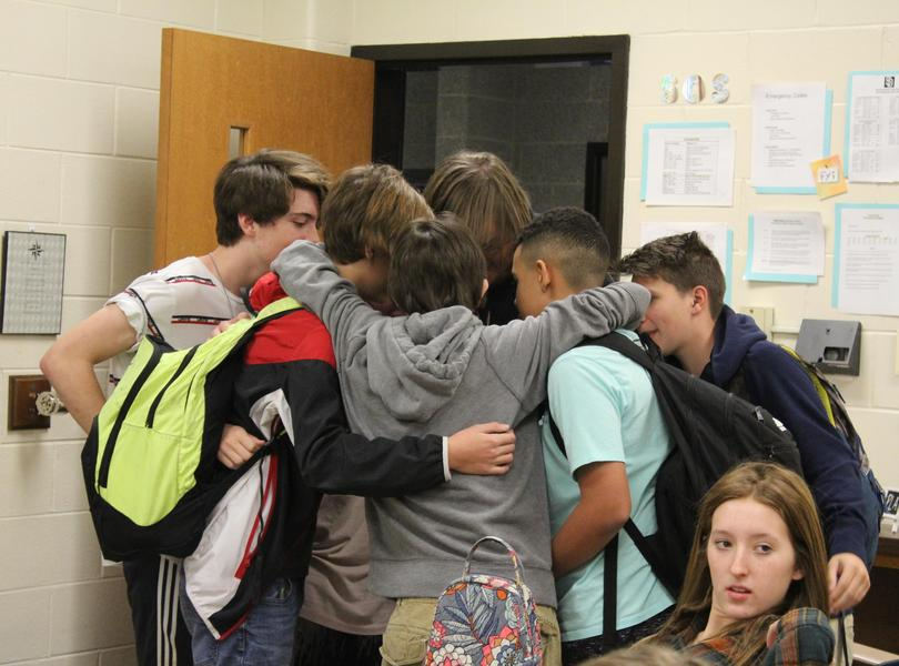 Students in huddle in class