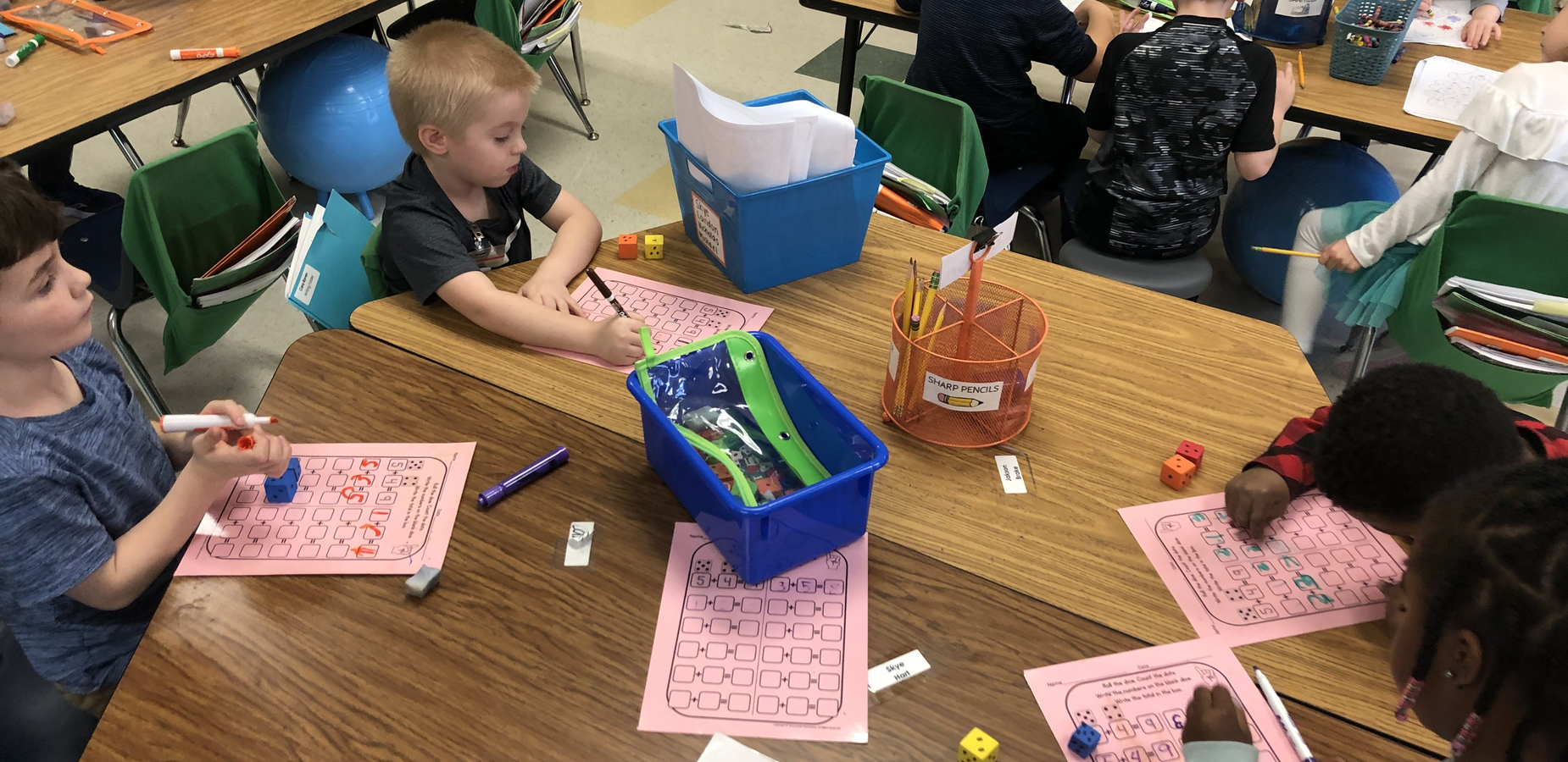 Kindergarten students working at a table