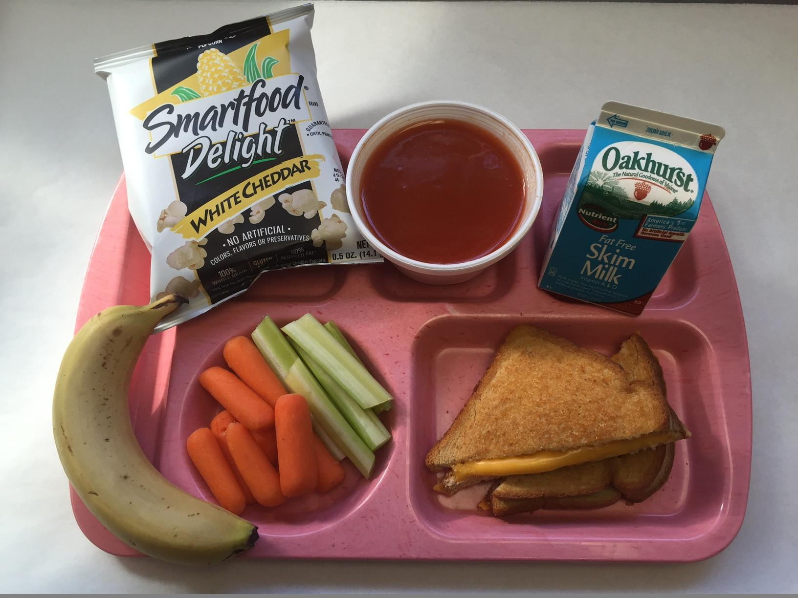 Toasted Cheese Sandwich, Tomato Soup, Veggie Sticks, Smartfood Popcorn, Banana and Milk
