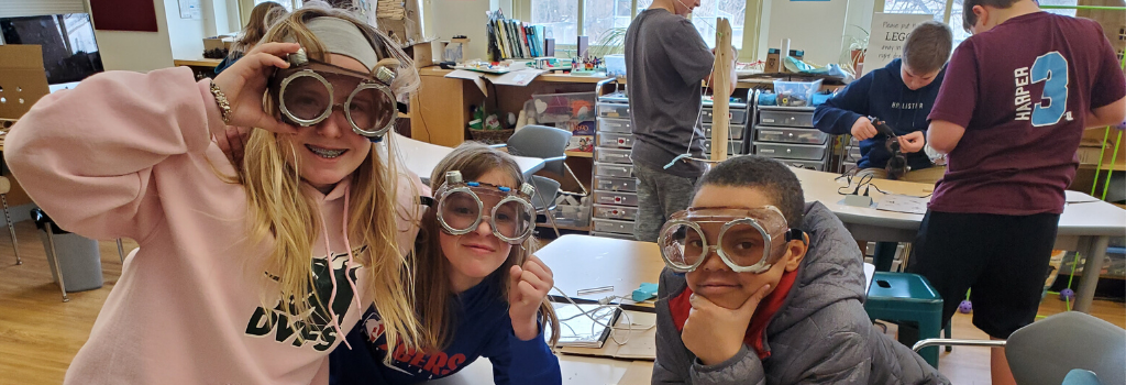 3 students wear the glasses made in Makerspace for the school musical.
