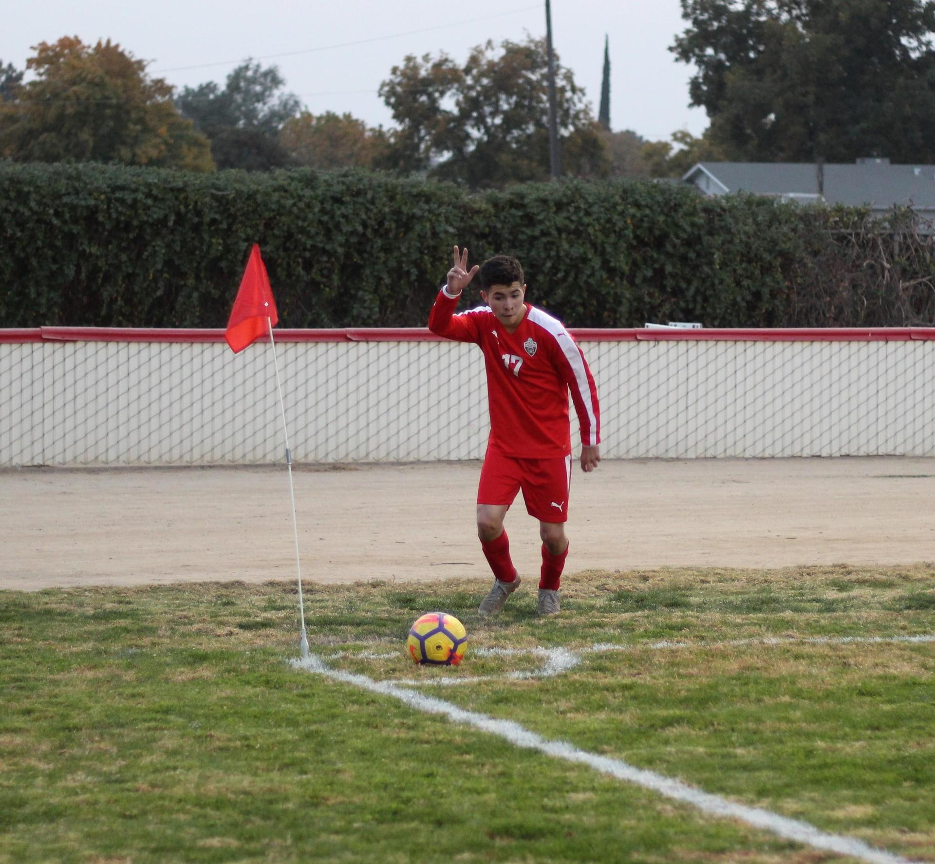 Luis Barajas Running to Kick the Ball