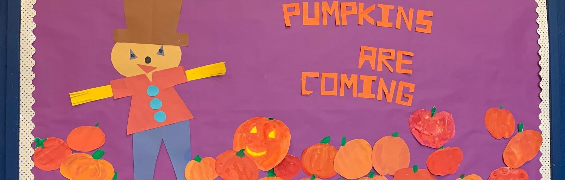 MPR Bulletin Board with pumpkin cutouts that says Pumpkins are Coming