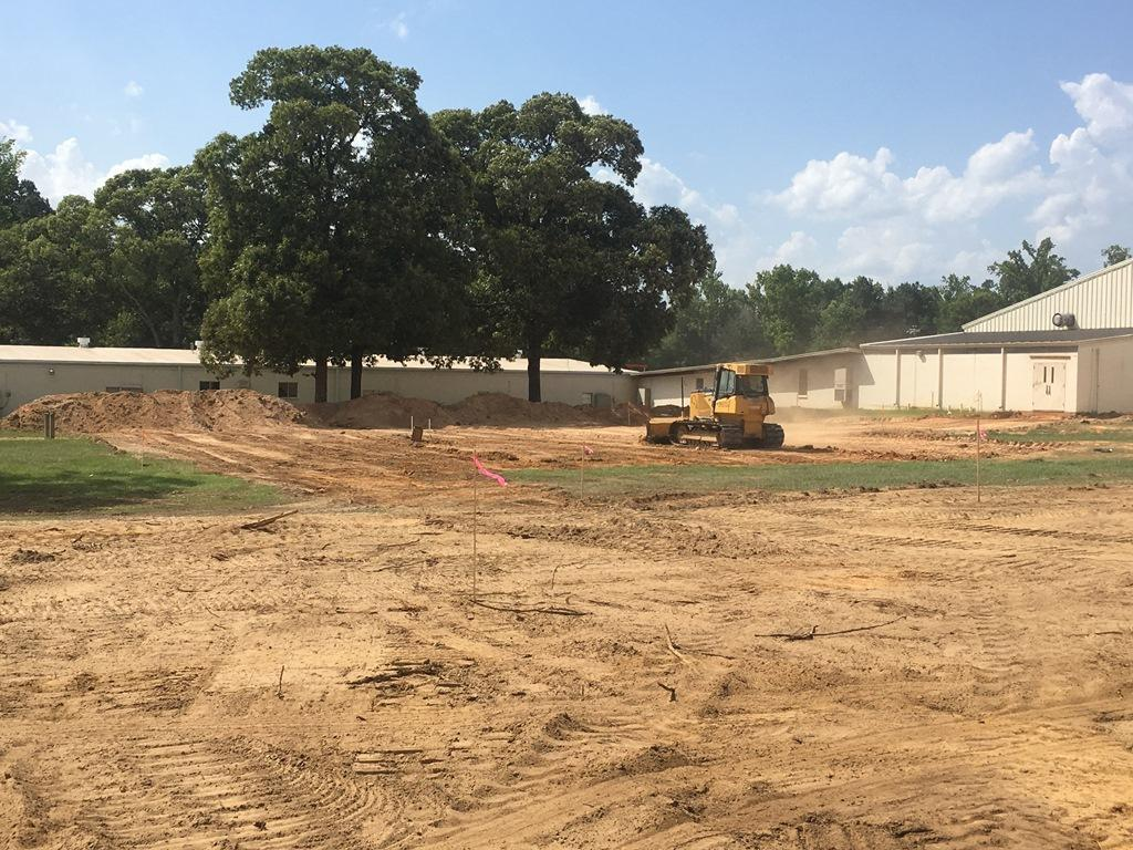 Heavy equipment clears land for CIS driveway