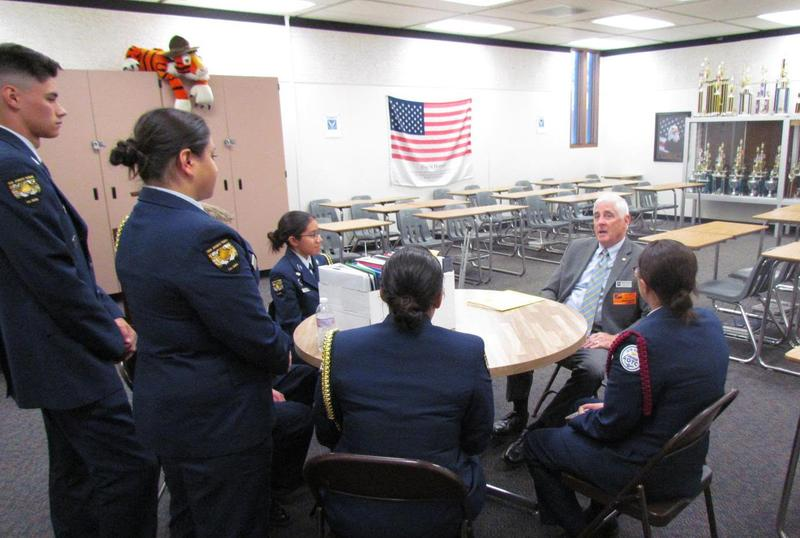 Col. (Retired) Ben Young, Jr., Air Force Junior ROTC Regional Director, discusses his findings with the unit's senior cadet leaders.