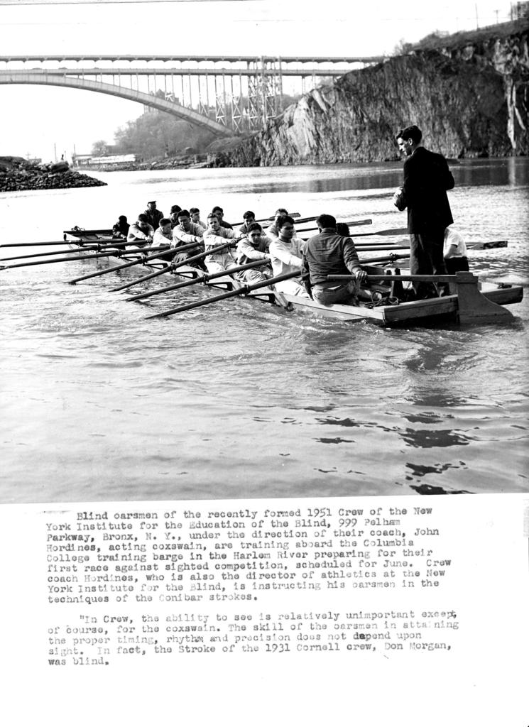 Students on the Harlem River working on the training boat their rowing skills.