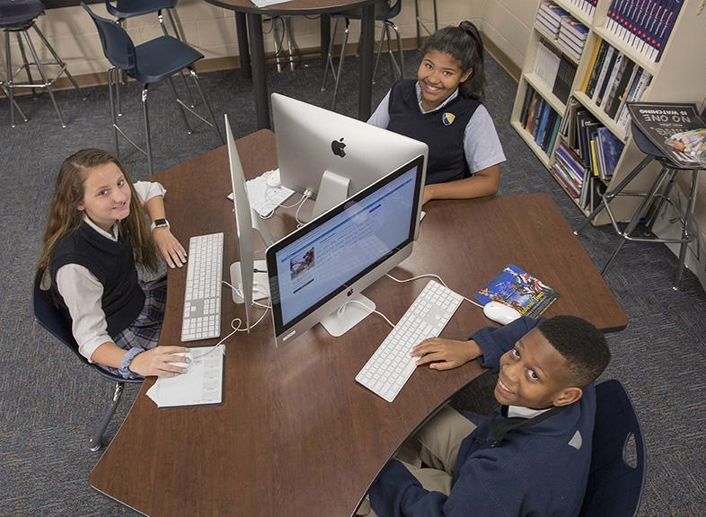Three ELCA students seated at an iMac pod in the Mac Lab.
