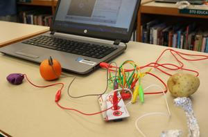 Photograph of playdoh, alligator clip and pieces of fruit used to build game controllers during a Makerspace session at Roosevelt Intermediate School.