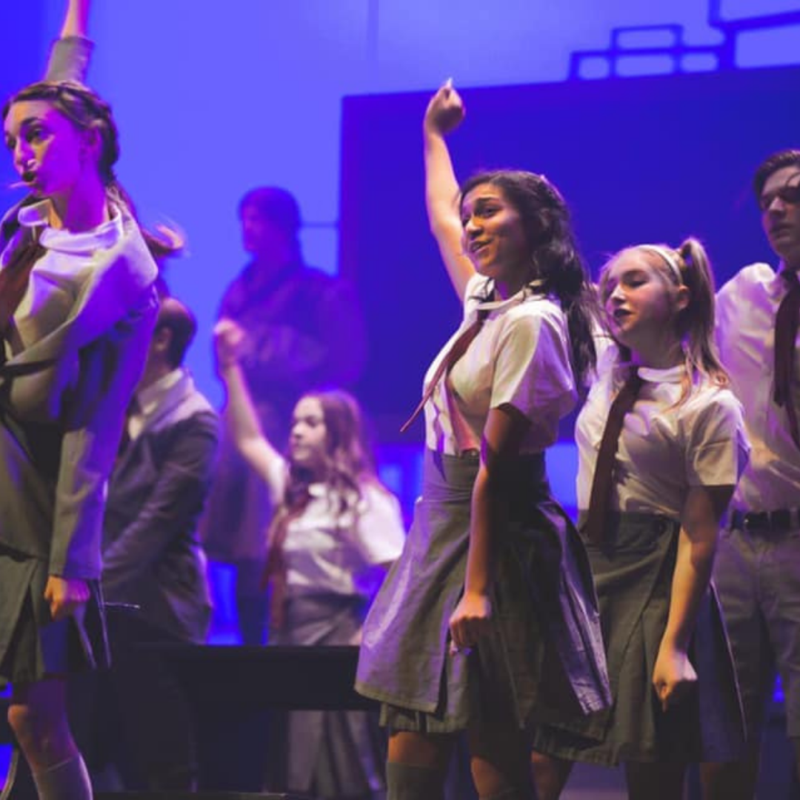 students on the stage performing Matilda