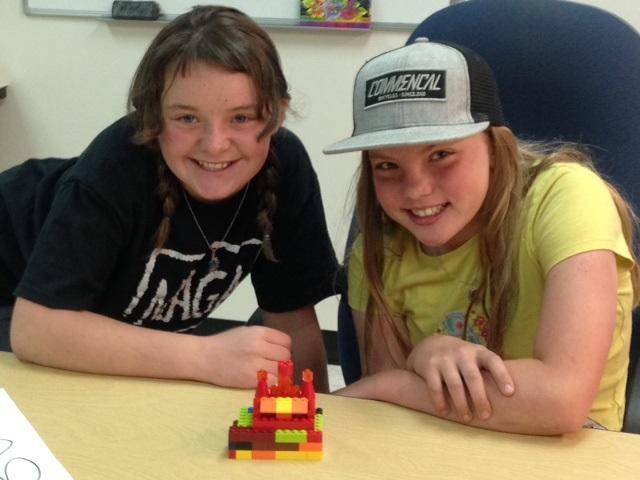Students pose with their Lego fire station