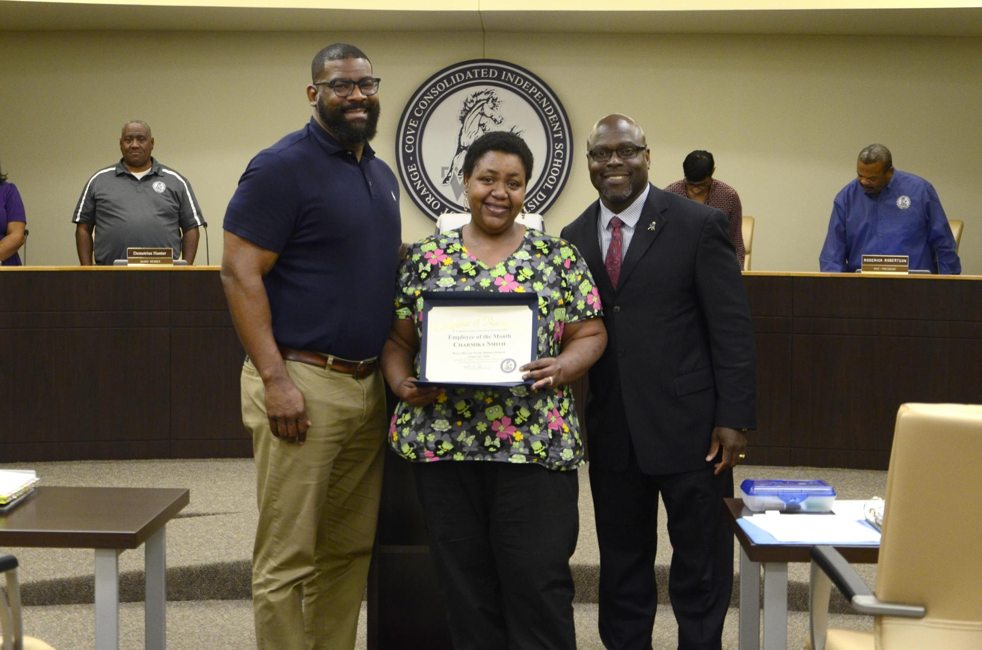 employee of February pictured with Dr. Harris and Mr. McGrew