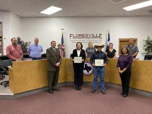 Students of the Month standing with Board of Trustees and Administration