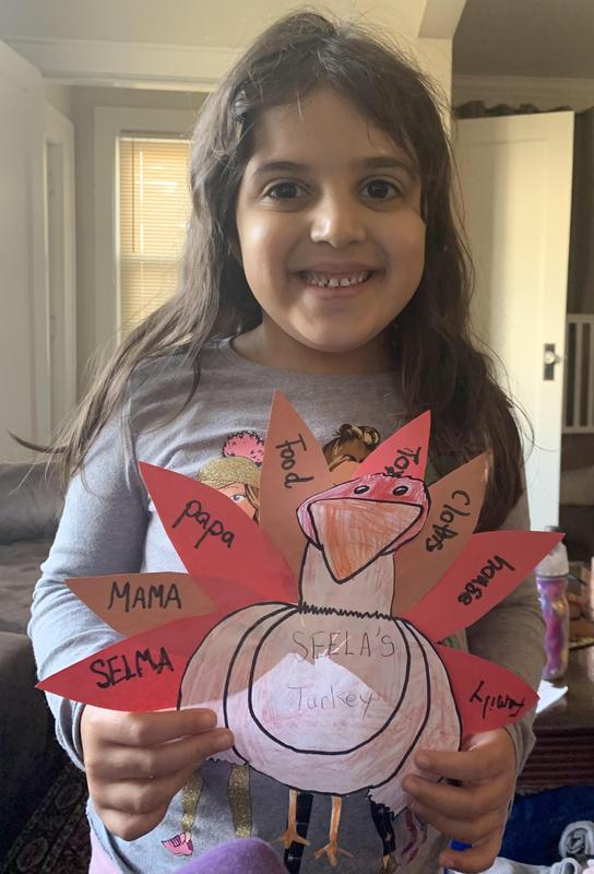 Student smiling with her turkey project