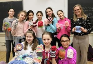 Members of the Looming our Love (LOL) Club at Roosevelt Intermediate School met to loom and knit caps for babies and adults in hospital cancer units.