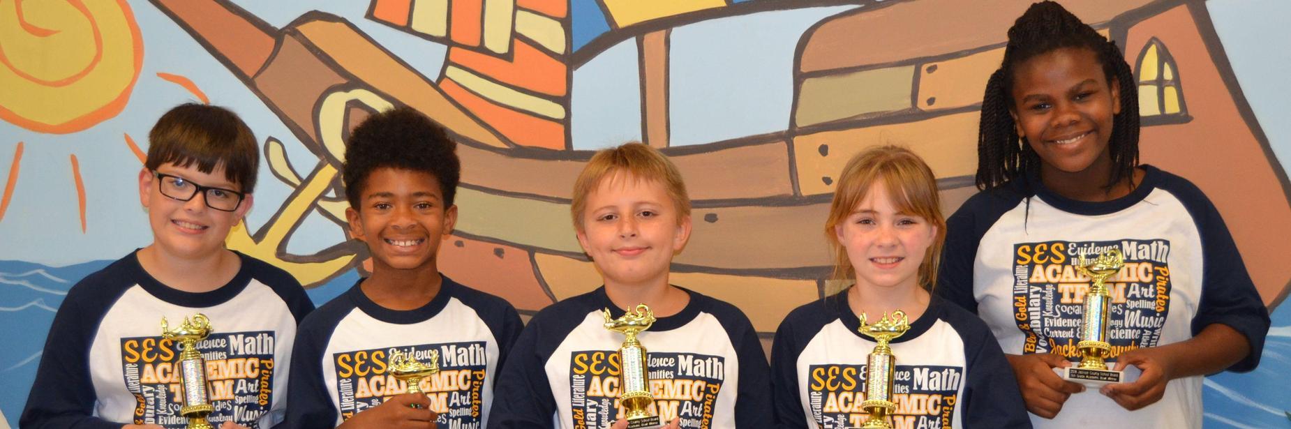ses students receiving trophies