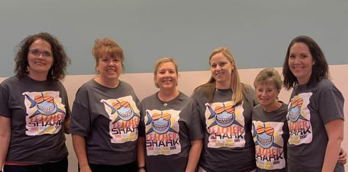 a group of women in matching tshirts