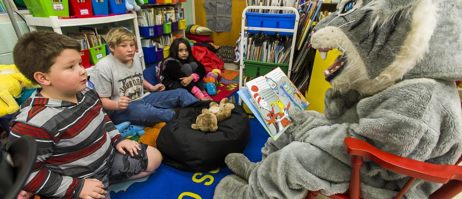 DBS Wildcat Mascot reads to DBS Students