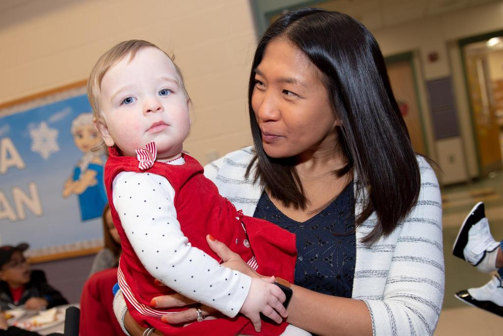 Assistant Principal Janet Taylor holds a toddler
