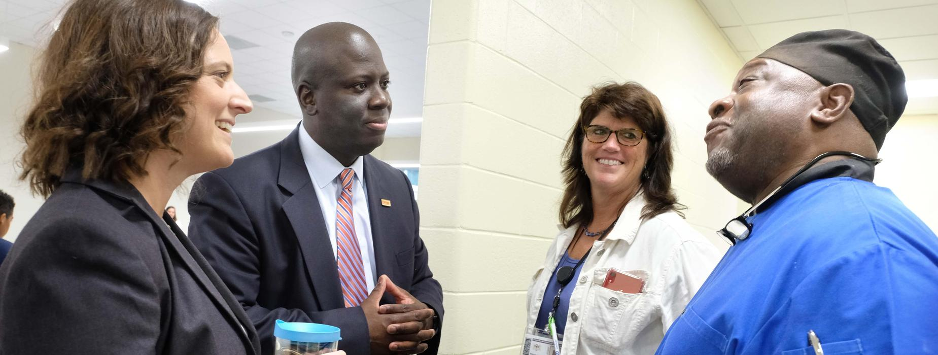 Superintendent Earnest Winston visits with staff