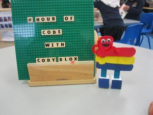 the hour of code with cody box sign and object