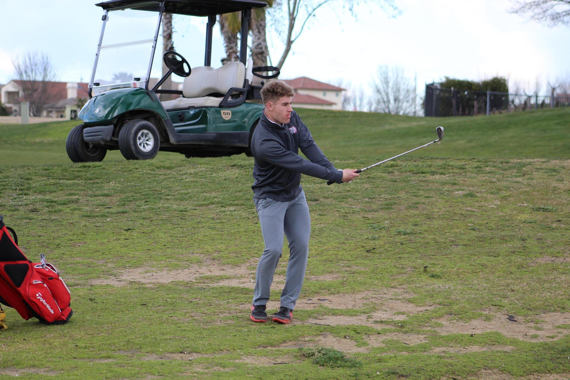 Boys golfers in action against El Capitan