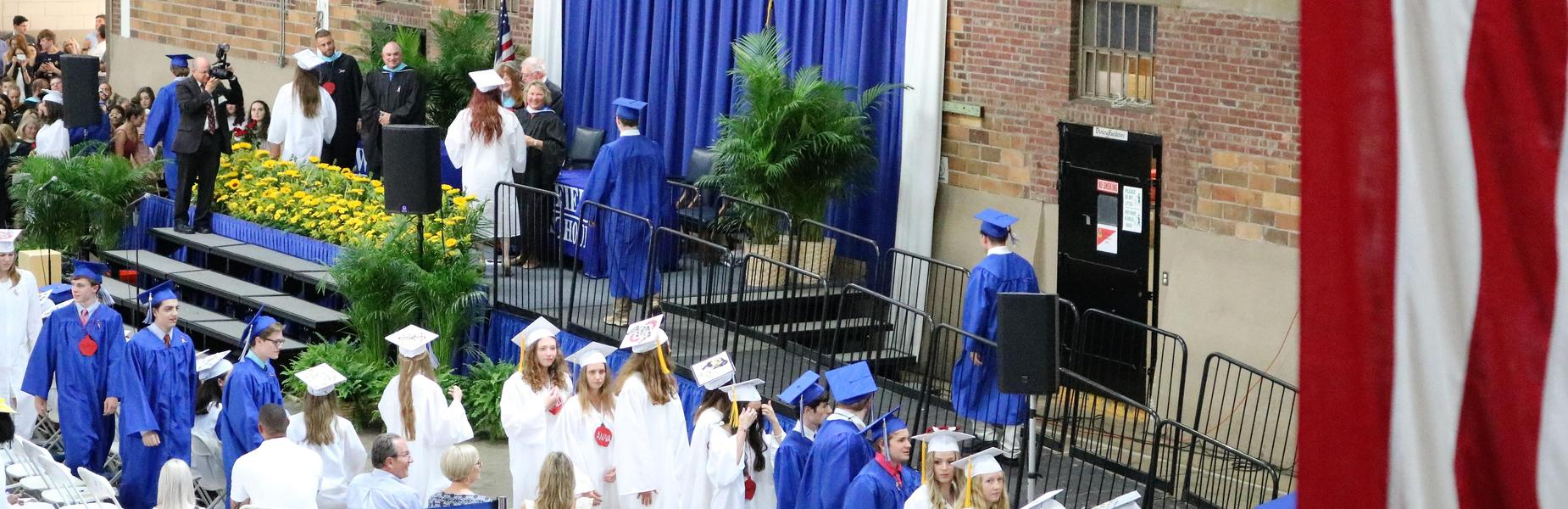 Photo of WHS Class of 2019 graduates in line to receive diplomas.